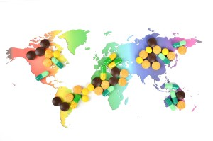 image of a world map with pills placed on top. Topic: Personalized Medicine in China